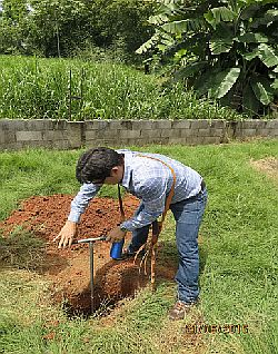 Highly qualified but expensive data.  A Costa Rican lawyer augering beneath a mini-pit in a non-hydric valley soil.