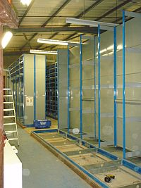Old archive roller shelving being dismantled before being rebuilt at Cranfield